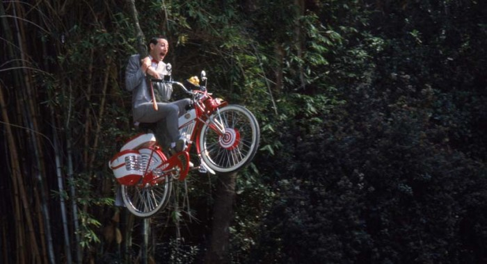 UNSPECIFIED - APRIL 02: Full shot of Pee-Wee Herman as Himself riding bicycle, swinging from vine. (Photo by Peter Sorel/Warner Bros./Getty Images)